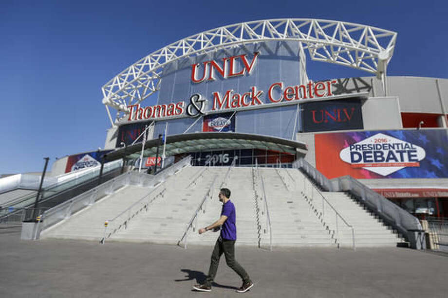 A pedestrian walks past the site for the third presidential debate between Republican presidential nominee Donald Trump and Democratic presidential nominee Hillary Clinton at UNLV in Las Vegas, Tuesday, Oct. 18, 2016. (AP Photo/Julio Cortez)