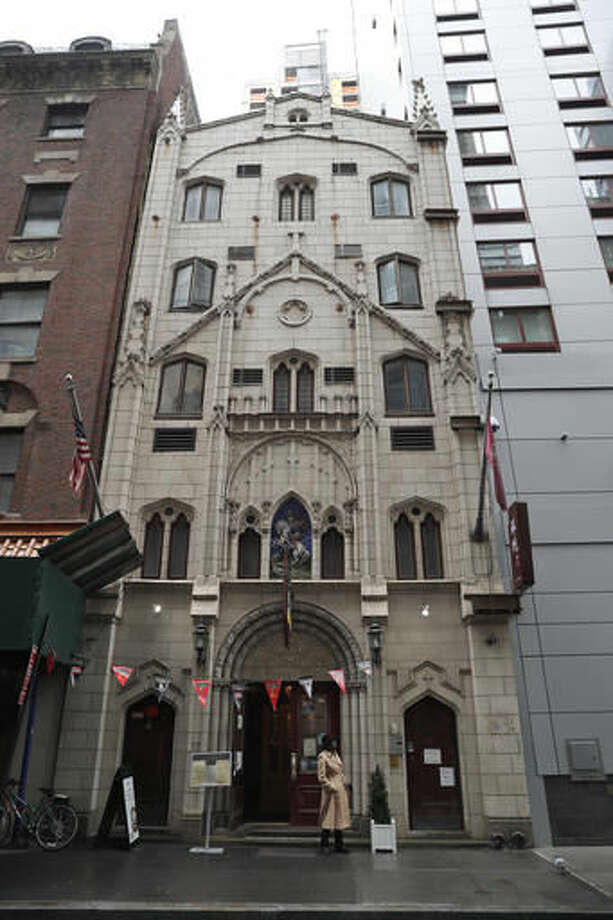 In this Sept. 30, 2016 photo, the former St. George's Syrian Catholic Church is seen in the financial district of New York in Manhattan. The church, which now houses two restaurants, was part of Little Syria, a neighborhood that existed between the 1880s and 1940s in Lower Manhattan and was composed of Arab-Americans, both Christians and Muslims, who arrived from what is now Syria and surrounding countries. (AP Photo/Mary Altaffer)