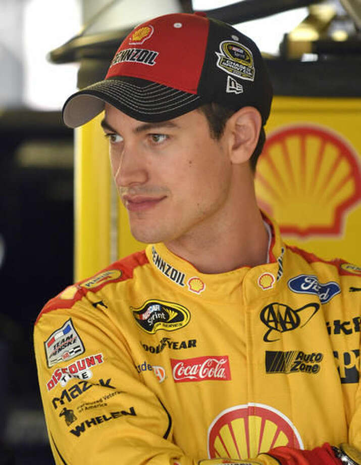 NASCAR Sprint Cup Series driver Joey Logano waits for auto racing practice at Kansas Speedway in Kansas City, Kan., Friday, Oct. 14, 2016. (AP Photo/Ed Zurga)