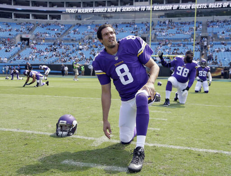 FILE - In this Sept. 18, 2016, file photo, Minnesota Vikings' Sam Bradford (8) stretches before an NFL football game against the Carolina Panthers in Charlotte, N.C. The Vikings could not have expected a better return from the trade they made with Philadelphia for quarterback Sam Bradford, and this week Bradford and the Vikings will have the opportunity to prove as much to the Eagles. (AP Photo/Bob Leverone, File)