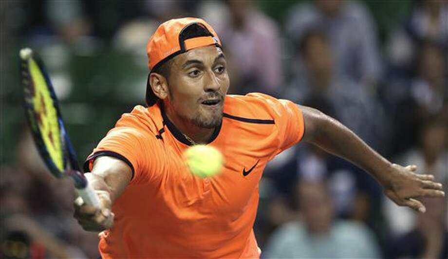 FILE - In this Saturday, Oct. 8, 2016, file photo, Australia's Nick Kyrgios returns a shot to Gael Monfils of France during the semifinal match of Japan Open tennis championships in Tokyo. The ATP has suspended Nick Kyrgios for at least 3 weeks and fined him extra $25,000 for conduct contrary to 'integrity' of tennis. (AP Photo/Koji Sasahara, File)