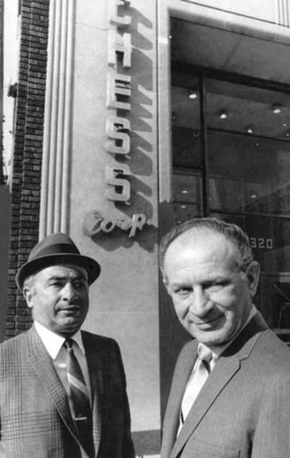 In this undated photo from left, Phil Chess and Leonard Chess stand outside their Chess Records headquarters in Chicago. Phil Chess, co-founder of a Chicago record label that amassed perhaps the most influential blues catalog, has died. He was 95. Nephew Craig Glicken told the Chicago Sun-Times on Wednesday Oct. 19, 2016, that Chess died overnight in Tucson, Arizona. Chess and his brother, Leonard, founded Chess Records in 1950, a label that included such stalwarts as Muddy Waters, Howlin' Wolf, Chuck Berry and Etta James. (Chicago Sun-Times via AP)