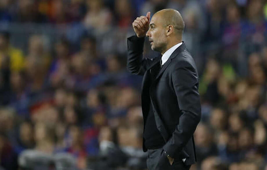 Manchester City's manager Pep Guardiola watches from the sideline during a Champions League, Group C soccer match between Barcelona and Manchester City, at the Camp Nou stadium in Barcelona, Wednesday, Oct. 19, 2016. (AP Photo/Francisco Seco)