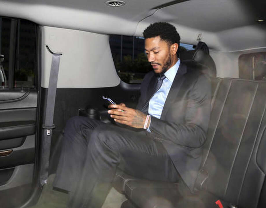NBA star Derrick Rose sits in a car after leaving federal court in Los Angeles Wednesday, Oct. 19, 2016. Jurors cleared Rose and two friends in a lawsuit that accused them of gang raping his ex-girlfriend when she was incapacitated from drugs or alcohol. The jury reached the verdict Wednesday in Los Angeles federal court after hearing dramatically different accounts of the August 2013 sexual encounter. (AP Photo/Nick Ut)
