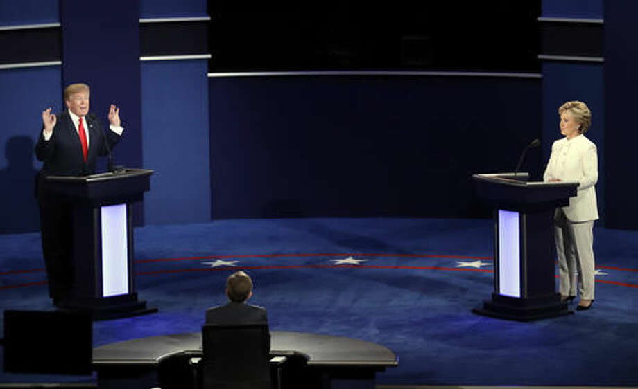 Republican presidential nominee Donald Trump debates Democratic presidential nominee Hillary Clinton during the third presidential debate at UNLV in Las Vegas, Wednesday, Oct. 19, 2016. (AP Photo/Julio Cortez)