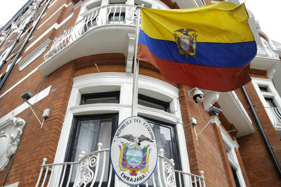 The Ecuadorian national flag flies outside their London Embassy, Tuesday, Oct. 18, 2016. Midway through releasing a series of damaging disclosures about U.S. presidential contender Hillary Clinton, WikiLeaks founder Julian Assange says his hosts at the Ecuadorean Embassy in London abruptly cut him off from the internet. The news adds another layer of intrigue to an extraordinary campaign. (AP Photo/Alastair Grant)