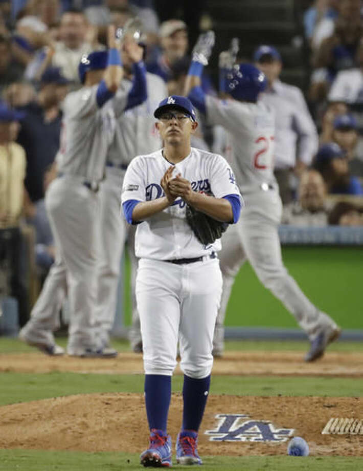 Los Angeles Dodgers starting pitcher Julio Urias reacts after giving up a two-run home run to Chicago Cubs' Addison Russell during the fourth inning of Game 4 of the National League baseball championship series Wednesday, Oct. 19, 2016, in Los Angeles. (AP Photo/Jae C. Hong)