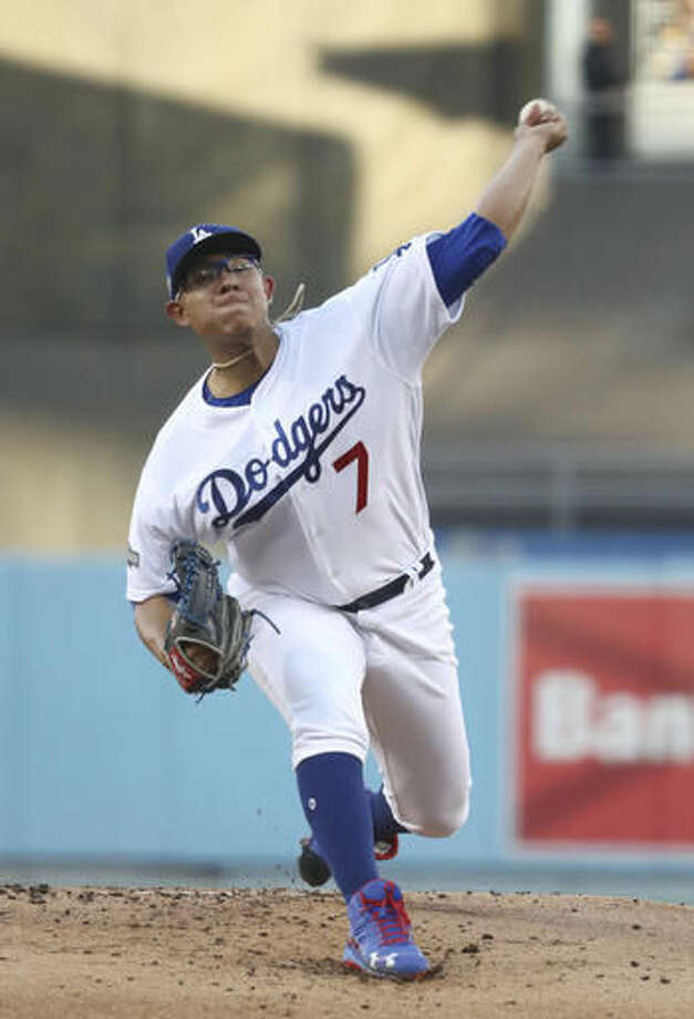 Los Angeles Dodgers starting pitcher Julio Urias throws during the first inning of Game 4 of the National League baseball championship series against the Chicago Cubs Wednesday, Oct. 19, 2016, in Los Angeles. (AP Photo/Sean M. Haffey, Pool)
