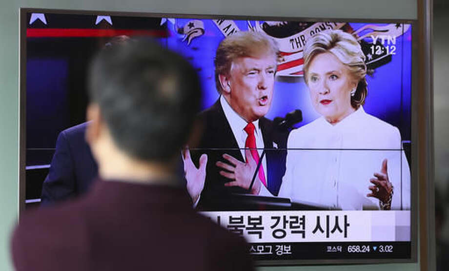 A man watches a TV screen showing the news program of the U.S. presidential debate between Democratic presidential nominee Hillary Clinton and Republican presidential nominee Donald Trump, at the Seoul Railway Station in Seoul, South Korea, Thursday, Oct. 20, 2016. (AP Photo/Lee Jin-man)