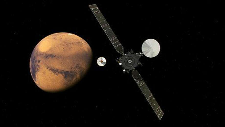 In this artist impression provided by the European Space Agency, ESA, the ExoMars Trace Gas Orbiter , TGO, right, and its entry, descent and landing demonstrator module, Schiaparelli, center, approaching Mars. The separation is scheduled to occur on Sunday Oct. 16, 2016, about seven months after launch. Schiaparelli is set to enter the martian atmosphere on Oct. 19, 2016 while TGO will enter orbit around Mars. The probe will take images of Mars and conduct scientific measurements on the surface, but its main purpose is to test technology for a future European Mars rover. Schiaparelli's mother ship will remain in orbit to analyze gases in the Martian atmosphere to help answer whether there is or was life on Mars. (ESA ATG/medialab via AP)
