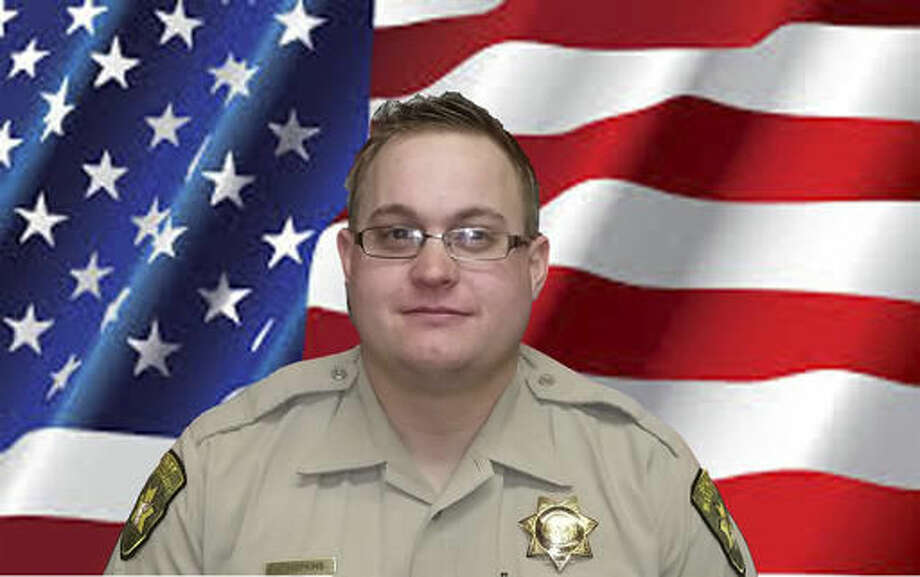 This undated photo provided by the Modoc County, Calif., Sheriff's Department shows Deputy Jack Hopkins. Hopkins, 31, was shot to death Wednesday, Oct. 19, 2016, while responding to a disturbance call, the Modoc County Sheriff's Office said. Deputies were responding to a call in a rural area about 10 miles south of Alturas, Calif., when deputy Hopkins, was fatally shot. A suspect was detained shortly after, the sheriff's office said. (Modoc County Sheriff's Department via AP)