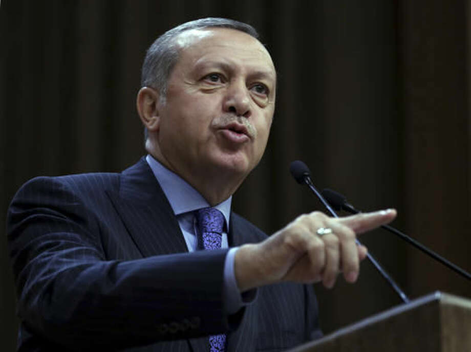 Turkey's President Recep Tayyip Erdogan addresses local administrators in Ankara, Turkey, Wednesday, Oct. 19, 2016. Erdogan has suggested Wednesday that forces he did not name were trying to keep Turkey away from the operation to liberate Mosul because his country was spoiling plans to change the sectarian balance in the region. His comments came amid heightened tensions with Iraq over the presence of Turkish troops in northern Iraq that are training Iraqi fighters to help retake Mosul. (Murat Cetinmuhurdar/Pool Photo via AP)
