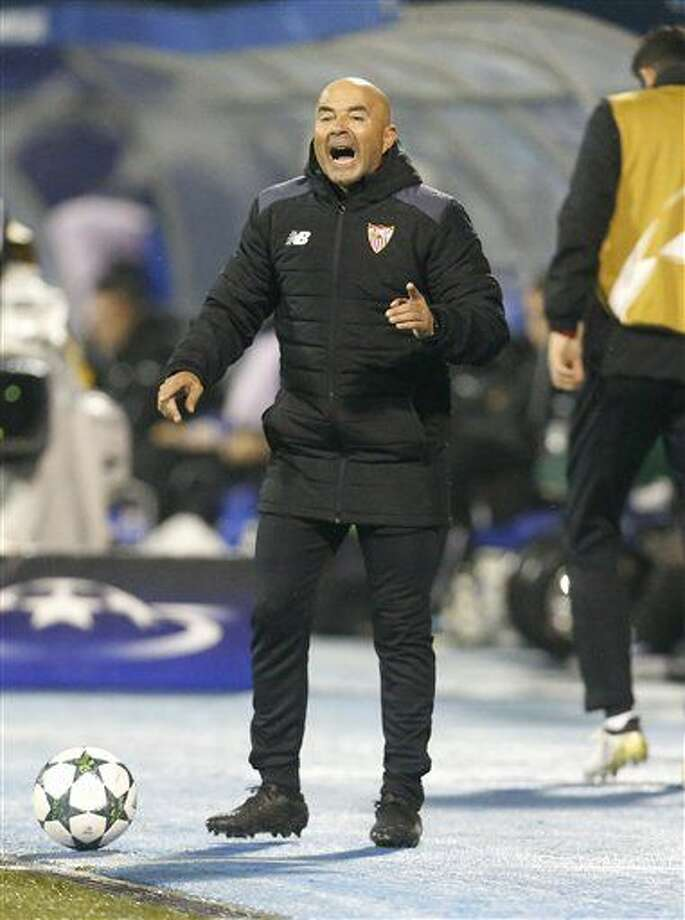 Sevilla's head coach Jorge Sampaoli gives instructions during the Champions League Group H soccer match between Dinamo Zagreb and Sevilla, at the Maksimir stadium in Zagreb, Croatia, Tuesday, Oct. 18, 2016. (AP Photo/Darko Bandic)