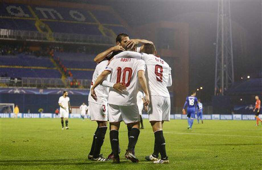 Sevilla's Samir Nasri, center, celebrates with his teammates after scoring during the Champions League Group H soccer match between Dinamo Zagreb and Sevilla, at the Maksimir stadium in Zagreb, Croatia, Tuesday, Oct. 18, 2016. (AP Photo/Darko Bandic)