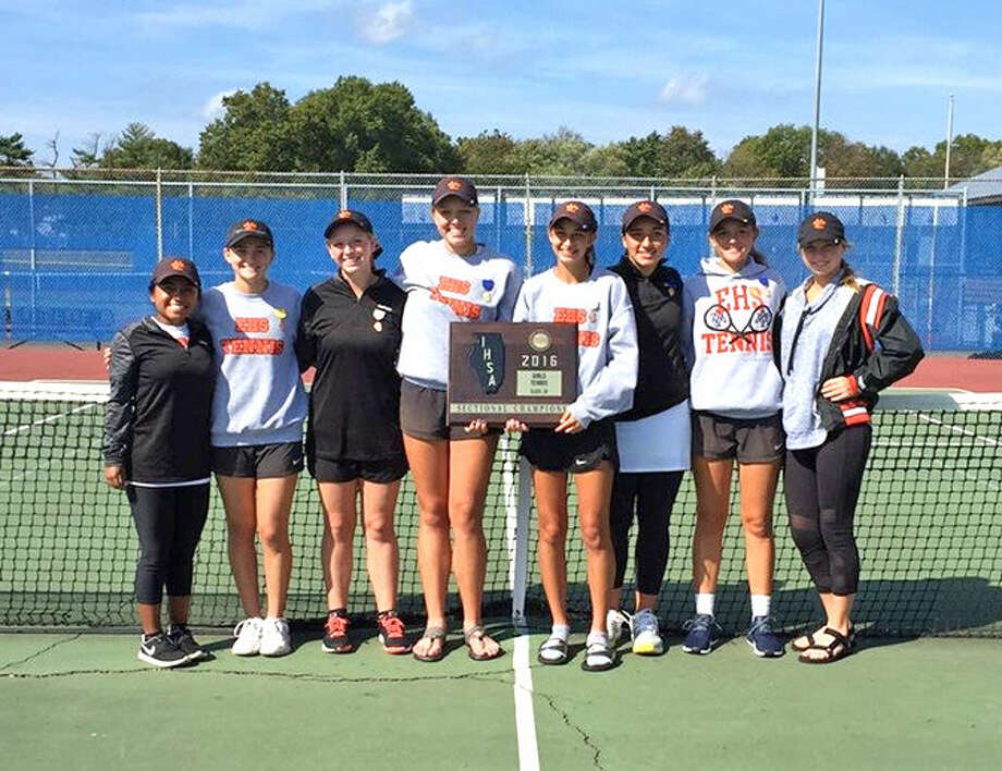 The Edwardsville girls' tennis team poses with the championship plaque last weekend after winning the Class 2A Belleville East Sectional.