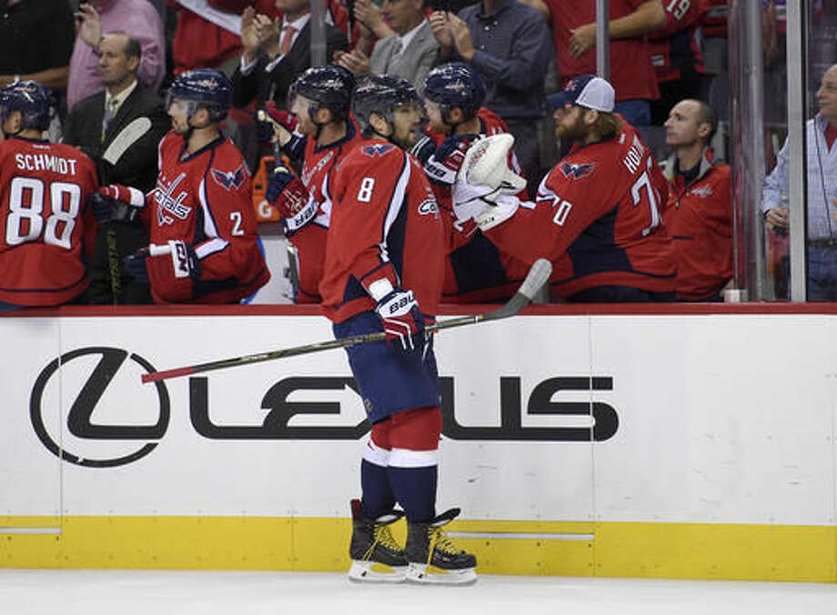 Washington Capitals left wing Alex Ovechkin (8), of Russia, celebrates his goal with Braden Holtby (70) during the first period of an NHL hockey game against the Colorado Avalanche, Tuesday, Oct. 18, 2016, in Washington. (AP Photo/Nick Wass)