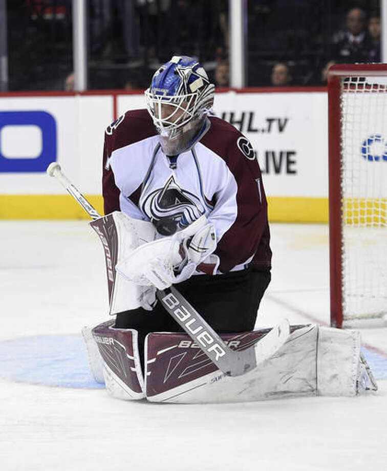 Colorado Avalanche goalie Semyon Varlamov, of Russia, stops the puck during the second period of an NHL hockey game against Washington Capitals, Tuesday, Oct. 18, 2016, in Washington. (AP Photo/Nick Wass)