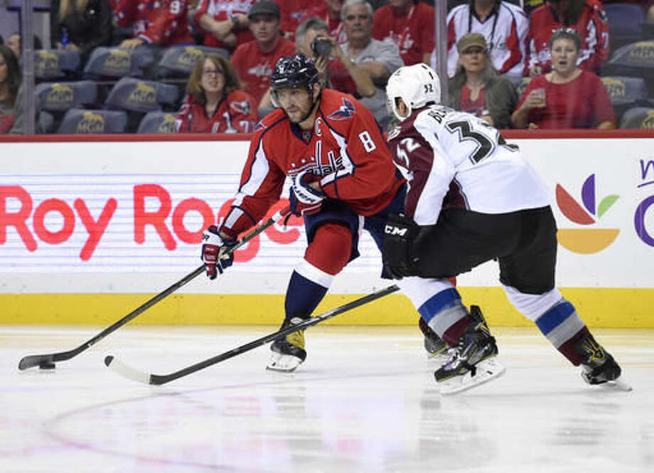 Washington Capitals left wing Alex Ovechkin (8), of Russia, skates with the puck against Colorado Avalanche defenseman Francois Beauchemin (32) during the second period of an NHL hockey game, Tuesday, Oct. 18, 2016, in Washington. (AP Photo/Nick Wass)