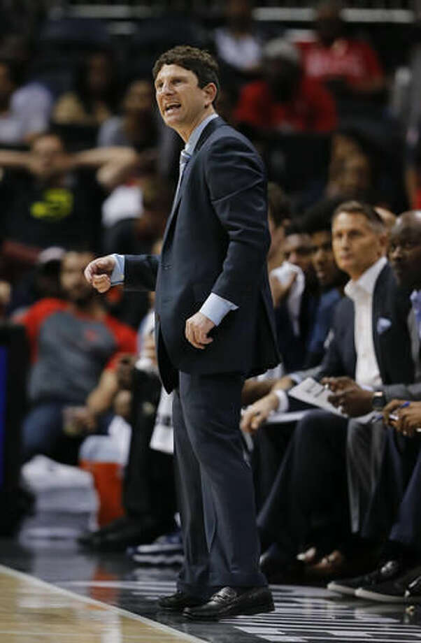 New Orleans Pelicans assistant coach Darren Erman yells to his players as he fills in for head coach Alvin Gentry, who was ill, during the first half of the team's preseason NBA basketball game against the Atlanta Hawks on Tuesday, Oct. 18, 2016, in Atlanta. (AP Photo/John Bazemore)