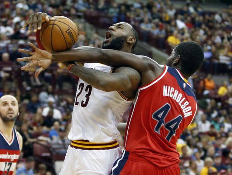 Washington Wizards' Andrew Nicholson, right, fouls Cleveland Cavaliers' LeBron James during the first half of an NBA preseason basketball game, Tuesday, Oct. 18, 2016, in Columbus, Ohio. (AP Photo/Jay LaPrete)