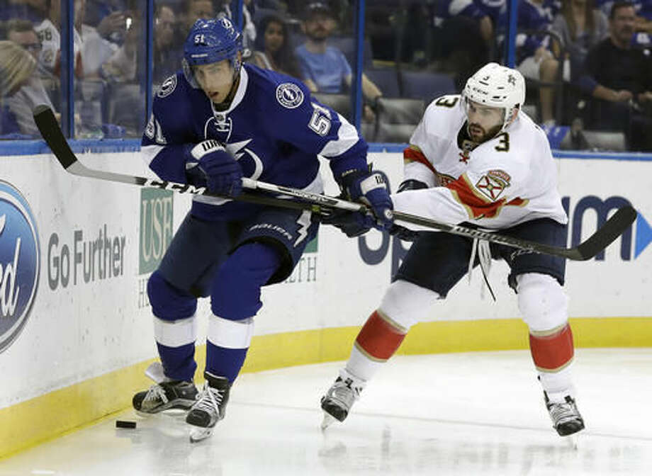 Tampa Bay Lightning center Valtteri Filppula (51), of Finland, and Florida Panthers defenseman Keith Yandle (3) vie for control of the puck during the second period of an NHL hockey game Tuesday, Oct. 18, 2016, in Tampa, Fla. (AP Photo/Chris O'Meara)