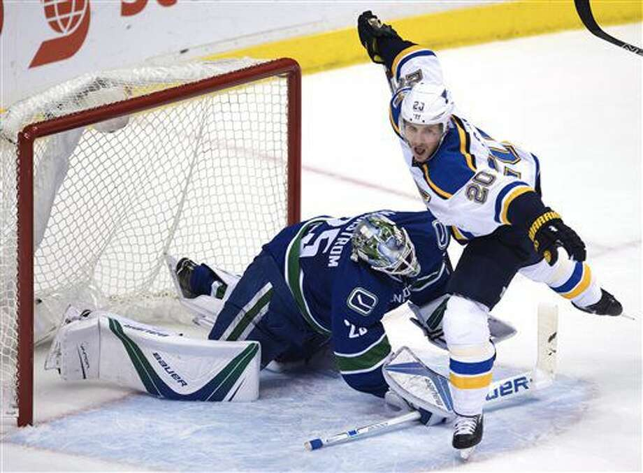 St. Louis Blues left wing Alexander Steen (20) is stopped by Vancouver Canucks goalie Jacob Markstrom (25) during the second period of an NHL hockey game Tuesday, Oct. 18, 2016, in Vancouver, British Columbia. (Jonathan Hayward/The Canadian Press via AP)