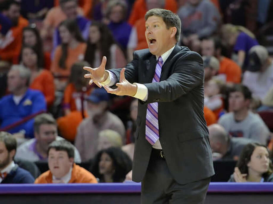 FILE - In this Jan. 16, 2016, file photo, Clemson head coach Brad Brownell reacts during the second half of an NCAA college basketball game against Miami in Greenville, S.C. Clemson basketball coaches Brad Brownell and Audra Smith are both thrilled with the school's renovated arena. They also understand that with a better building come increased expectations for programs that have not made the NCAA Tournament in a while. The renovation of the 47-year-old building cost $63.5 million.(AP Photo/Richard Shiro, File)