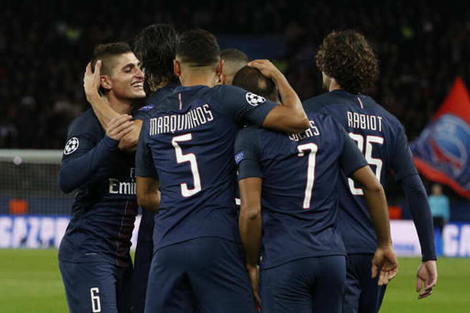 PSG players celebrate after teammate Lucas scored during the Champions League group A soccer match between Paris Saint Germain and Basel at the Parc des Princes stadium in Paris, Wednesday, Oct. 19, 2016. (AP Photo/Christophe Ena)