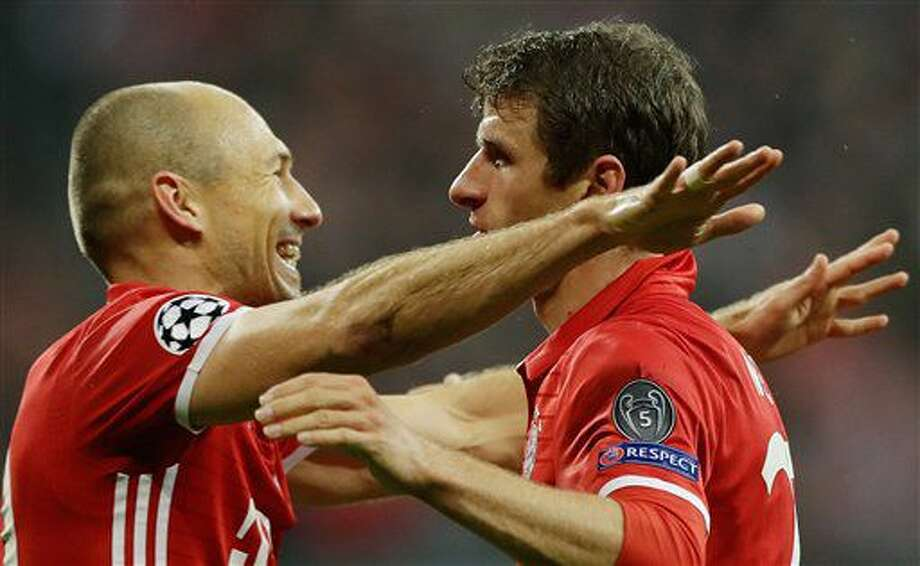 Bayern's Thomas Mueller, right, celebrates with his teammate Arjen Robben after scoring the opening goal during the Champions League Group D soccer match between FC Bayern Munich and PSV Eindhoven, at Allianz Arena stadium in Munich, Germany, Wednesday, Oct. 19, 2016. (AP Photo/Matthias Schrader)
