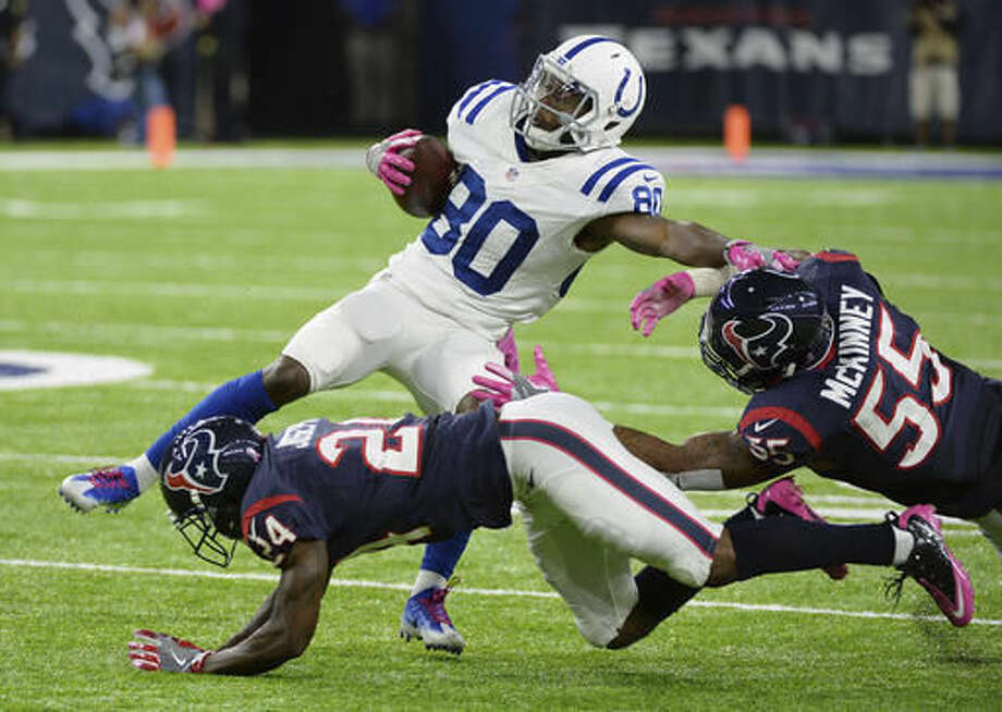 Indianapolis Colts wide receiver Chester Rogers (80) is hit by Houston Texans defenders Johnathan Joseph (24) and Benardrick McKinney (55) after a catch during the first half of an NFL football game, Sunday, Oct. 16, 2016, in Houston. (AP Photo/George Bridges)
