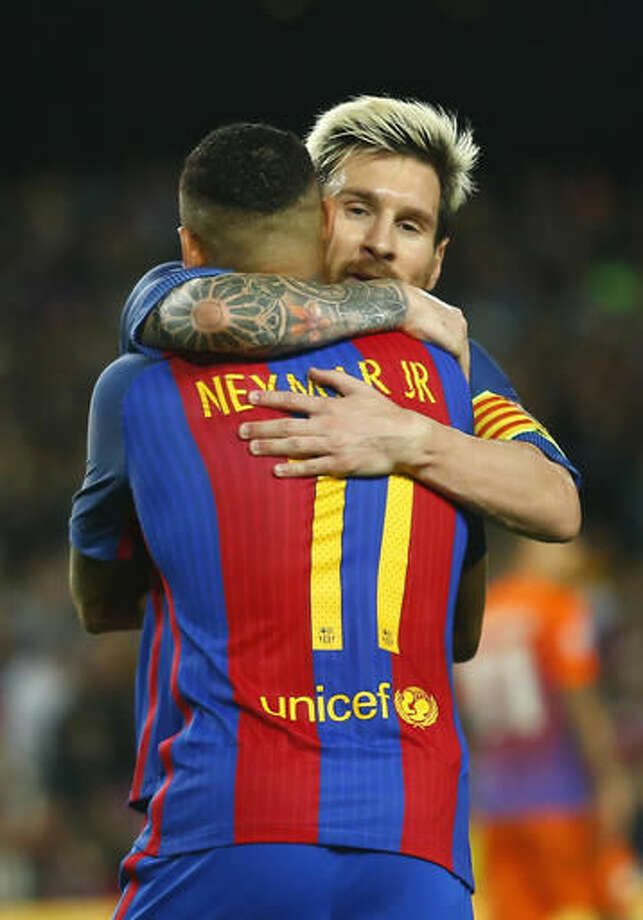 Barcelona's Neymar, left, celebrates with Lionel Messi after scoring his side's fourth goal during a Champions League, Group C soccer match between Barcelona and Manchester City, at the Camp Nou stadium in Barcelona, Wednesday, Oct. 19, 2016. (AP Photo/Francisco Seco)