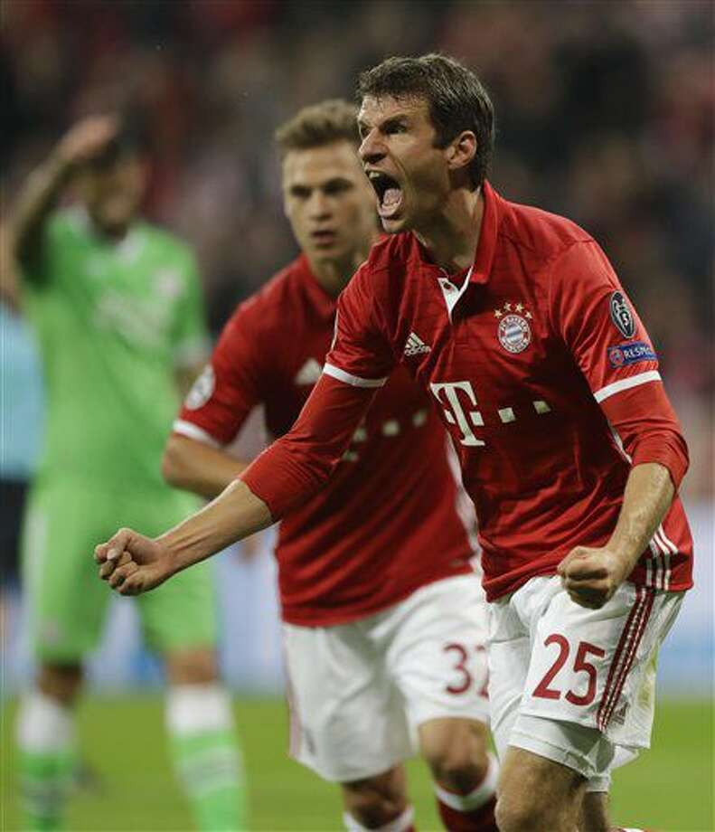 Bayern's Thomas Mueller celebrates after scoring the opening goal during the Champions League Group D soccer match between FC Bayern Munich and PSV Eindhoven, at Allianz Arena stadium in Munich, Germany, Wednesday, Oct. 19, 2016. (AP Photo/Matthias Schrader)
