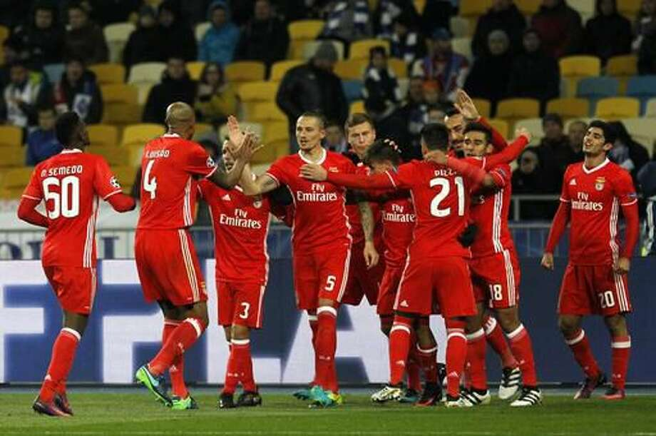 Benfica's team players celebrate their second goal against Dynamo Kiev during the Champions League Group B soccer match between Dynamo Kiev and Benfica at the Olympiyskiy stadium in Kiev, Ukraine, Wednesday, Oct. 19, 2016. (AP Photo/Sergei Chuzavkov)