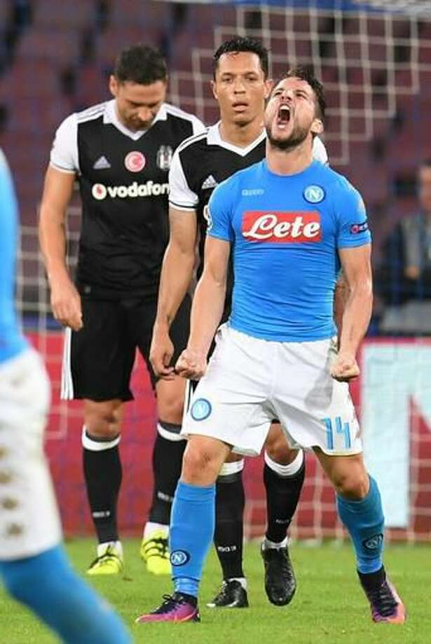 Napoli's Dries Mertens celebrates after scoring during a Champions League, group B soccer match, between Napoli and Besiktas at the San Paolo stadium in Naples, Italy, Oct. 19, 2016. (Ciro Fusco/ANSA via AP)