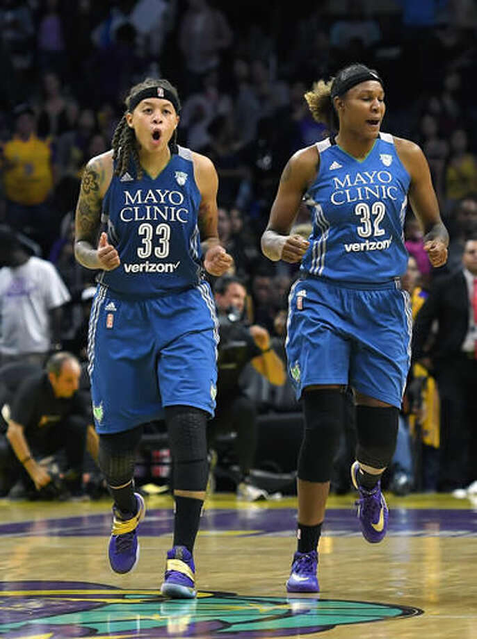 Minnesota Lynx guard Seimone Augustus, left, and forward Rebekkah Brunson celebrates during the second half in Game 4 of the WNBA Finals against the Los Angeles Sparks, Sunday, Oct. 16, 2016, in Los Angeles. The Lynx won 85-79. (AP Photo/Mark J. Terrill)