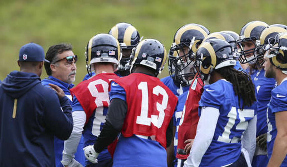 LA Rams head coach Jeff Fisher, second left, leads a training session in Bagshot, England, Wednesday Oct. 19, 2016. The Los Angeles Rams are due to play the New York Jets at Twickenham stadium in London on Sunday in a regular season NFL game. (Sean Ryan/NFL via AP)