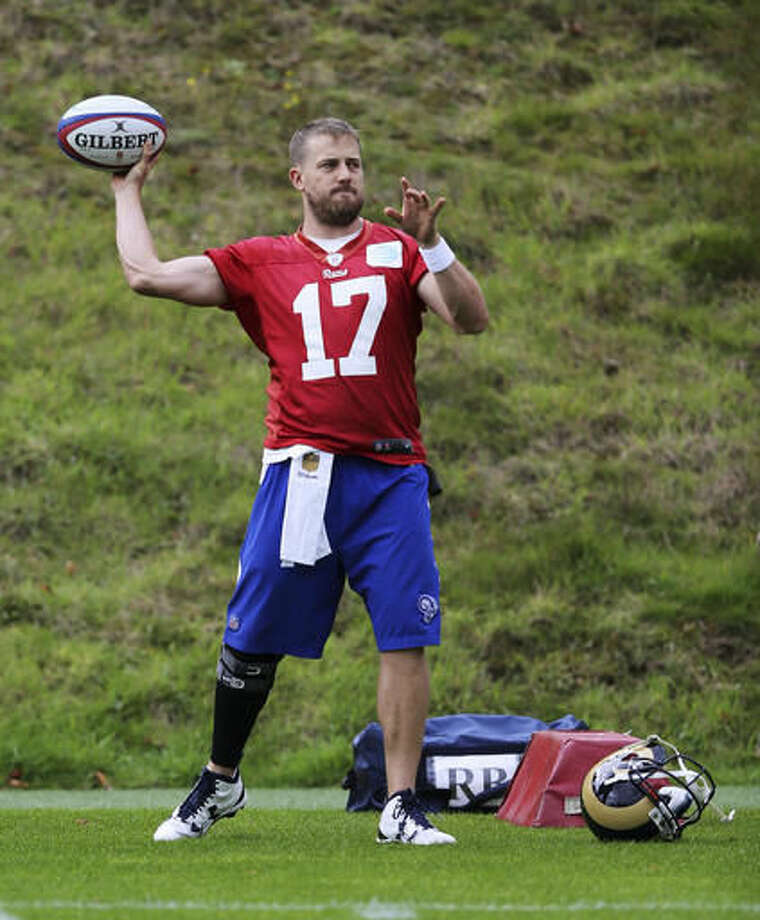 LA Rams quarterback Case Keenum, throws a rugby ball during warm-up prior to a training session in Bagshot, England, Wednesday Oct. 19, 2016. The Los Angeles Rams are due to play the New York Jets at Twickenham stadium in London on Sunday in a regular season NFL game. (Sean Ryan/NFL via AP)