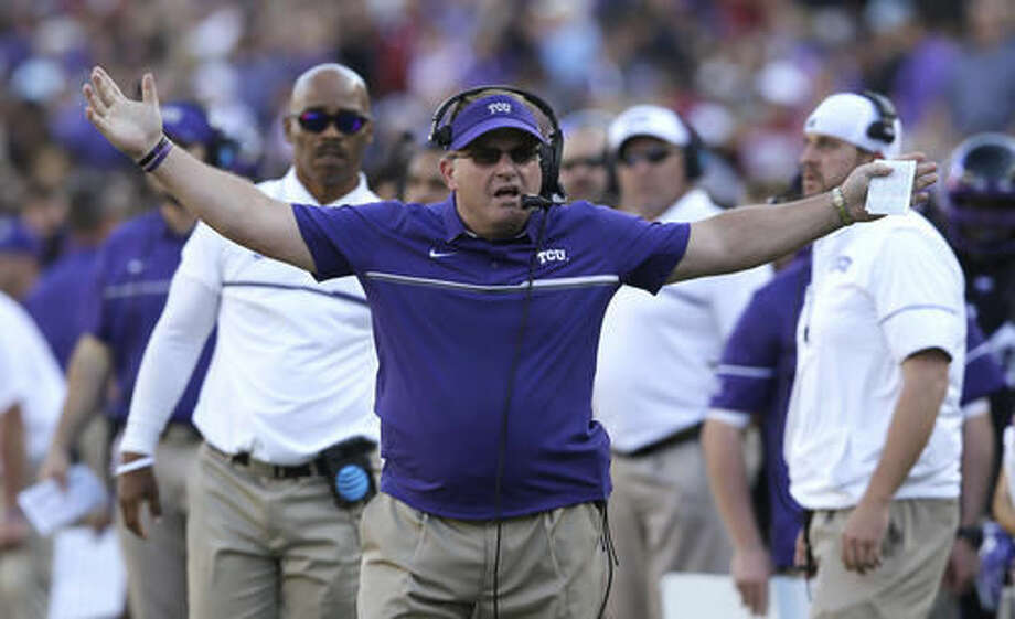 FILE - In this Oct. 1, 2016, file photo, TCU coach Gary Patterson reacts to a play during the team's NCAA college football game against Oklahoma in Fort Worth, Texas. Now that the Big 12 has decided to stay at 10 schools, it's time to figure out whether or not to split up _ into football divisions. If so, how will the teams be divided? The league, which will keep its round-robin schedule, has to determine who will play in its championship game that returns next season. (AP Photo/LM Otero, File)