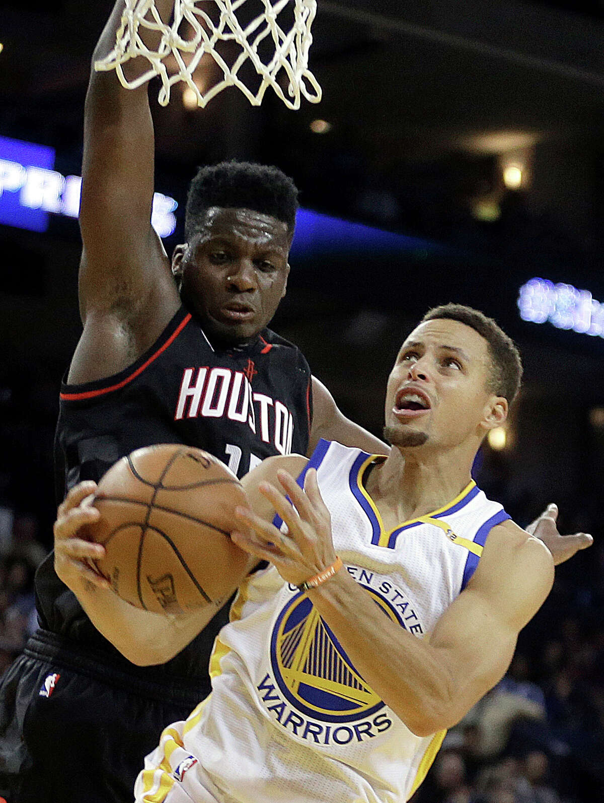 Golden State Warriors' Stephen Curry, right, shoots against Houston Rockets' Clint Capela during the second half of an NBA basketball game Thursday, Dec. 1, 2016, in Oakland, Calif. Houston won 132-127 in double overtime. (AP Photo/Ben Margot)