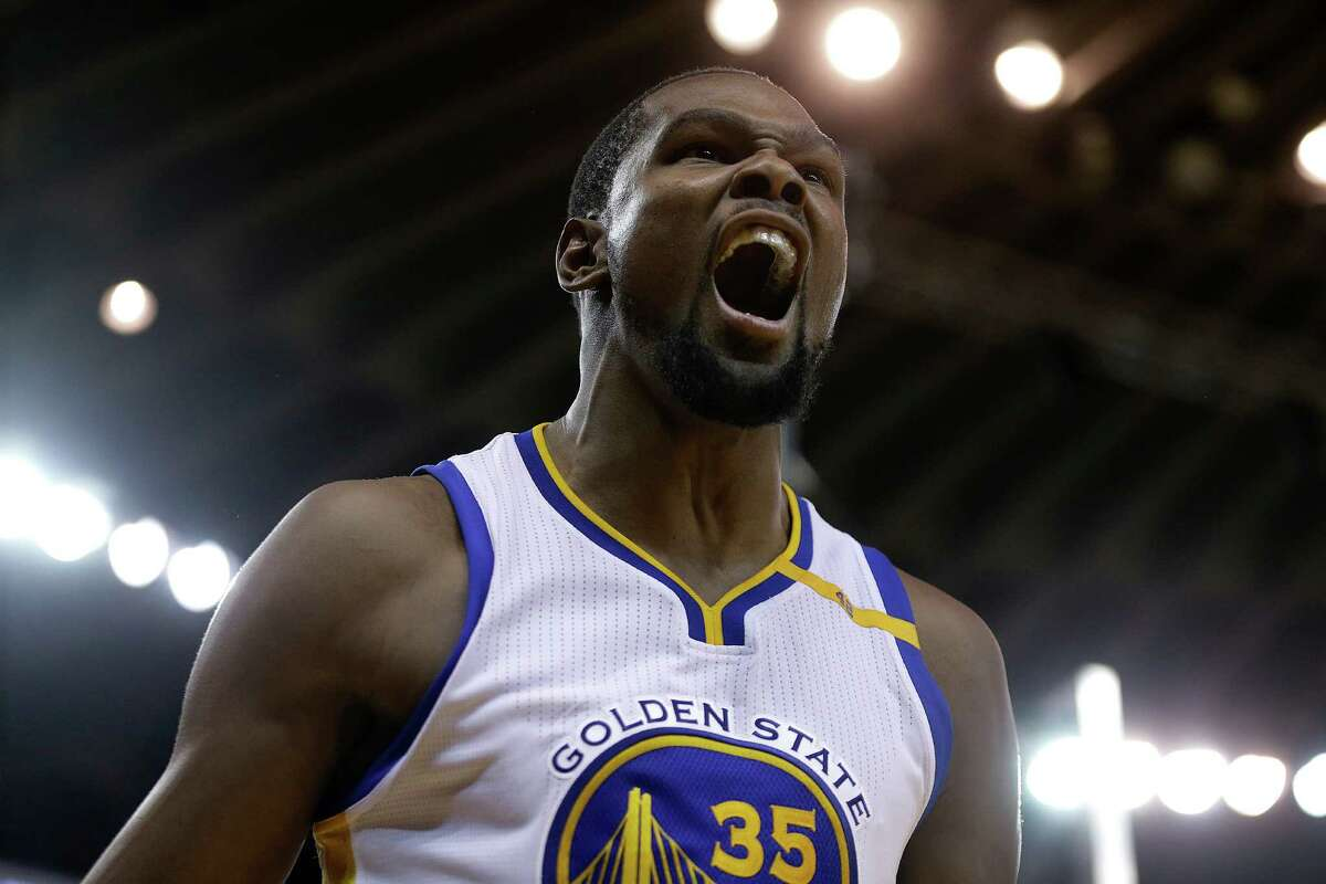 Golden State Warriors' Kevin Durant celebrates after scoring against the Houston Rockets during the second half of an NBA basketball game Thursday, Dec. 1, 2016, in Oakland, Calif. Houston won 132-127 in double overtime. (AP Photo/Ben Margot)