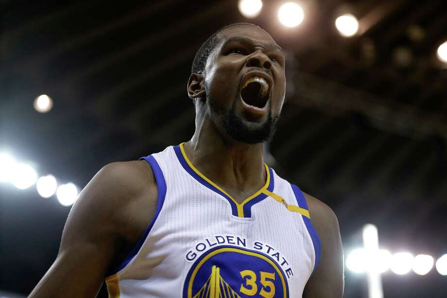 Golden State Warriors' Kevin Durant celebrates after scoring against the Houston Rockets during the second half of an NBA basketball game Thursday, Dec. 1, 2016, in Oakland, Calif. Houston won 132-127 in double overtime. (AP Photo/Ben Margot) Photo: Ben Margot, Associated Press / AP