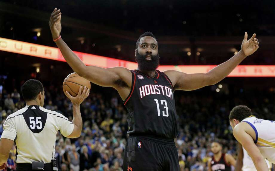 Houston Rockets' James Harden (13) gestures to fans during the second half of an NBA basketball game against the Golden State Warriors Thursday, Dec. 1, 2016, in Oakland, Calif. Houston won 132-127 in double overtime. (AP Photo/Ben Margot) Photo: Ben Margot, Associated Press / Copyright 2016 The Associated Press. All rights reserved.