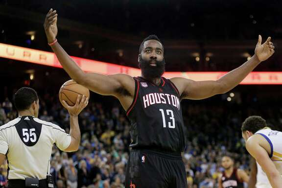 Houston Rockets' James Harden (13) gestures to fans during the second half of an NBA basketball game against the Golden State Warriors Thursday, Dec. 1, 2016, in Oakland, Calif. Houston won 132-127 in double overtime. (AP Photo/Ben Margot)