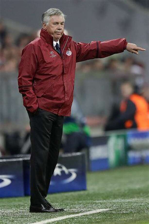 Bayern's head coach Carlo Ancelotti gestures during the Champions League Group D soccer match between FC Bayern Munich and PSV Eindhoven, at Allianz Arena stadium in Munich, Germany, Wednesday, Oct. 19, 2016. (AP Photo/Matthias Schrader)