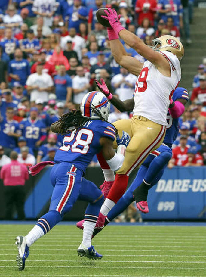 San Francisco 49ers tight end Vance McDonald (89) makes a catch over Buffalo Bills cornerback Ronald Darby (28) during the second half of an NFL football game on Sunday, Oct. 16, 2016, in Orchard Park, N.Y. (AP Photo/Bill Wippert)