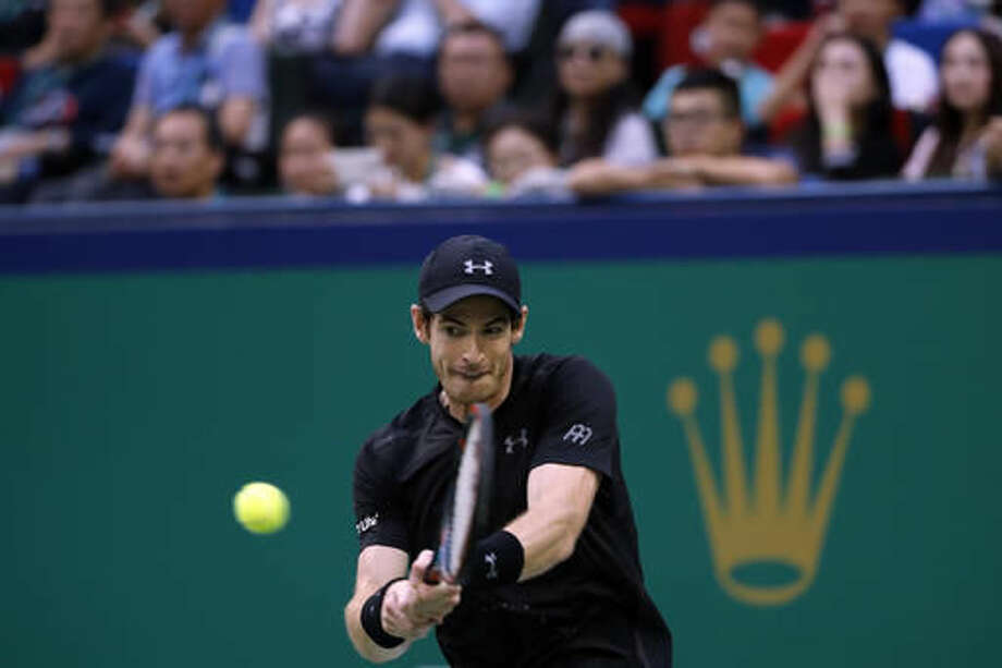 Andy Murray of Britain hits a return shot against Roberto Bautista Agut of Spain during the men's singles final of the Shanghai Masters tennis tournament at Qizhong Forest Sports City Tennis Center in Shanghai, China, Sunday, Oct. 16, 2016. (AP Photo/Andy Wong)