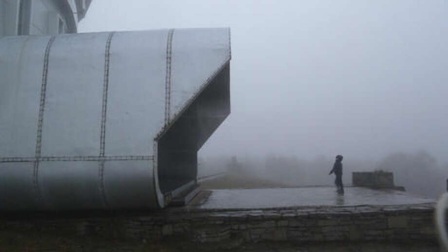 In this photo taken Saturday, Oct. 15, 2016 a child approaches the main entrance of the Astrophysical Observatory at Nizhny Arkhyz, in Karachay-Cherkessia, southern Russia. Set high in the mountains of the North Caucasus, the Special Astrophysical Observatory of the Russian Academy of Sciences once housed the world's largest space telescope when it was opened in the 1970s. The observatory is now the setting foe an art exhibition that explores the near-infinite reaches of both outer space and the human imagination. (AP Photo/Kate de Pury)