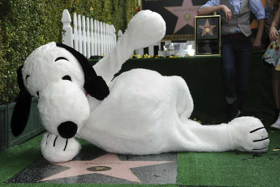 FILE - In a Nov. 2, 2015 file photo, Snoopy is honored with a star on the Hollywood Walk of Fame, in Los Angeles. MetLife announced Thursday, Oct. 20, 2016 that they will phase out its use of Snoopy and the Peanuts Gang as a brand after more than 30 years. MetLife will be rolling out the new brand globally through 2017.(Photo by Richard Shotwell/Invision/AP, File)