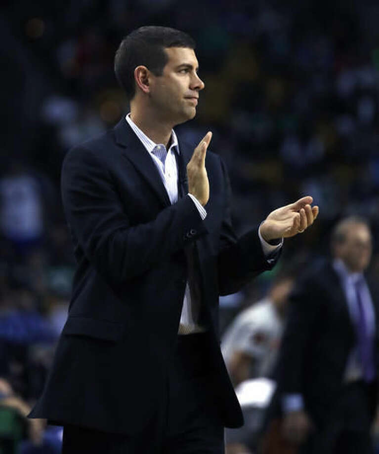 Boston Celtics coach Brad Stevens applauds during the second quarter of the team's preseason NBA basketball game against the New York Knicks in Boston, Wednesday, Oct. 19, 2016. (AP Photo/Charles Krupa)