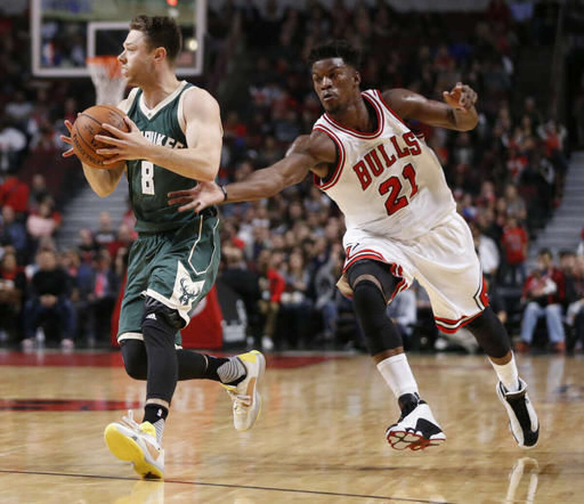 FILE - In this Oct. 3, 2016 file photo, Chicago Bulls guard Jimmy Butler tries to knock the ball away from Milwaukee Bucks guard Matthew Dellavedova during an NBA preseason basketball in Chicago. The Bulls figure to be a whole lot more interesting this season with the additions of Dwyane Wade and Rajon Rondo. (AP Photo/Charles Rex Arbogast File)